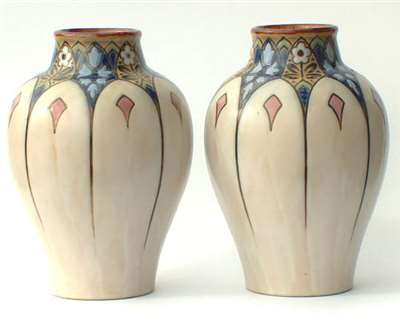 Pair of 1920's Royal Doulton vases by Ada Tosen
