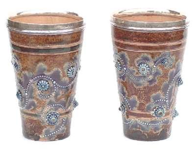 Pair of silver rimmed beakers by George Tinworth