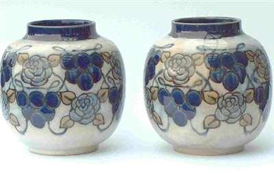Pair of vases by Margaret E. Thomson